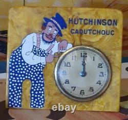Ancienne pendule Pneus HUTCHINSON Rémouleur et chien garage année 30