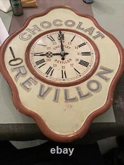 Ancienne pendule chocolat revillon en tole peinte 1900
