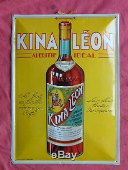 Ancienne plaque non émaillée bombée publicitaire pour l' apéritif KINA LEON