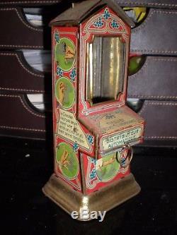 Distributeur chocolat en tole fonctionnel tirelire des petits gourmands 1940