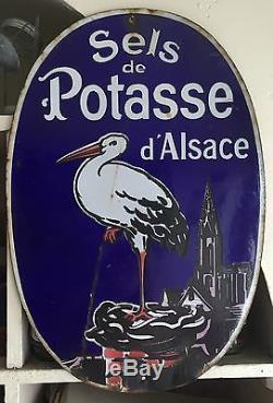 Plaque émaillée ancienne SELS POTASSE D'ALSACE Cigogne EDMOND JEAN 20's