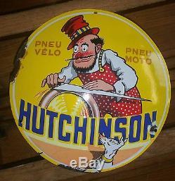 Plaque émaillée ronde bombée pneus Hutchinson le rémouleur et son chien