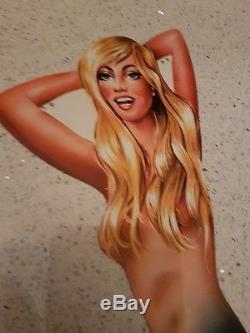 Rare pin up en tôle DUNLOP la blonde